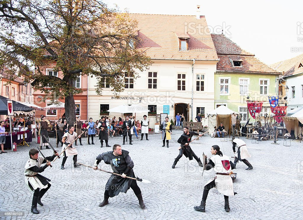 he medieval knights fighting. Sighisoara, Romania royalty-free stock photo