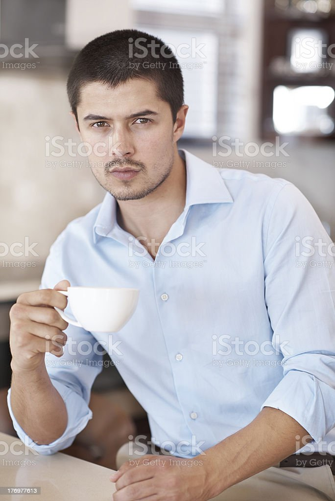 He nevers starts the day without some coffee royalty-free stock photo