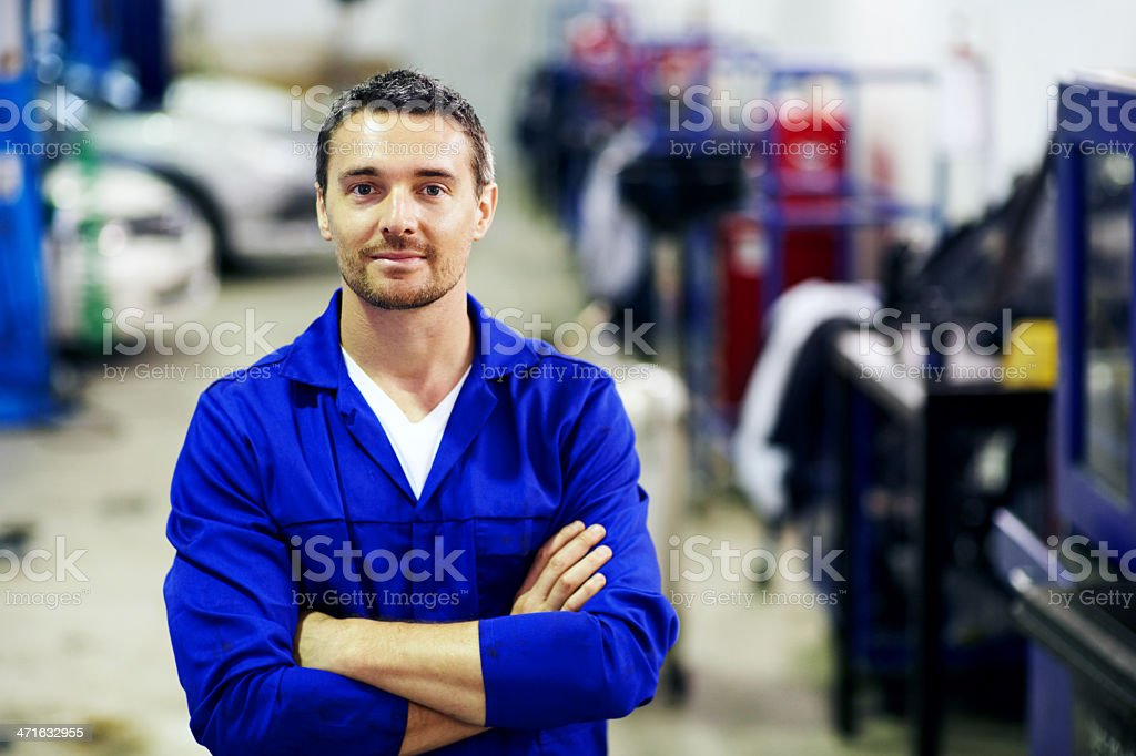 He offers a trustworthy vehicle maintenance service royalty-free stock photo