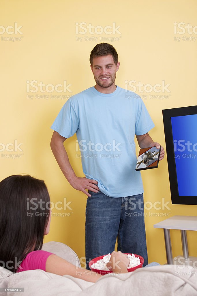 He Picks The Movie royalty-free stock photo