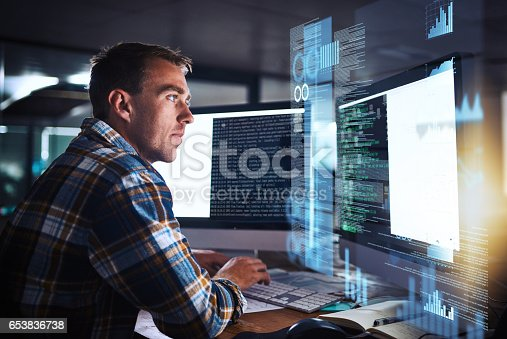 Shot of a young programmer working at his computer with an overlay of computer graphics