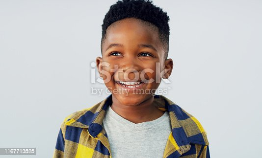 Shot of an adorable little boy posing against a white background