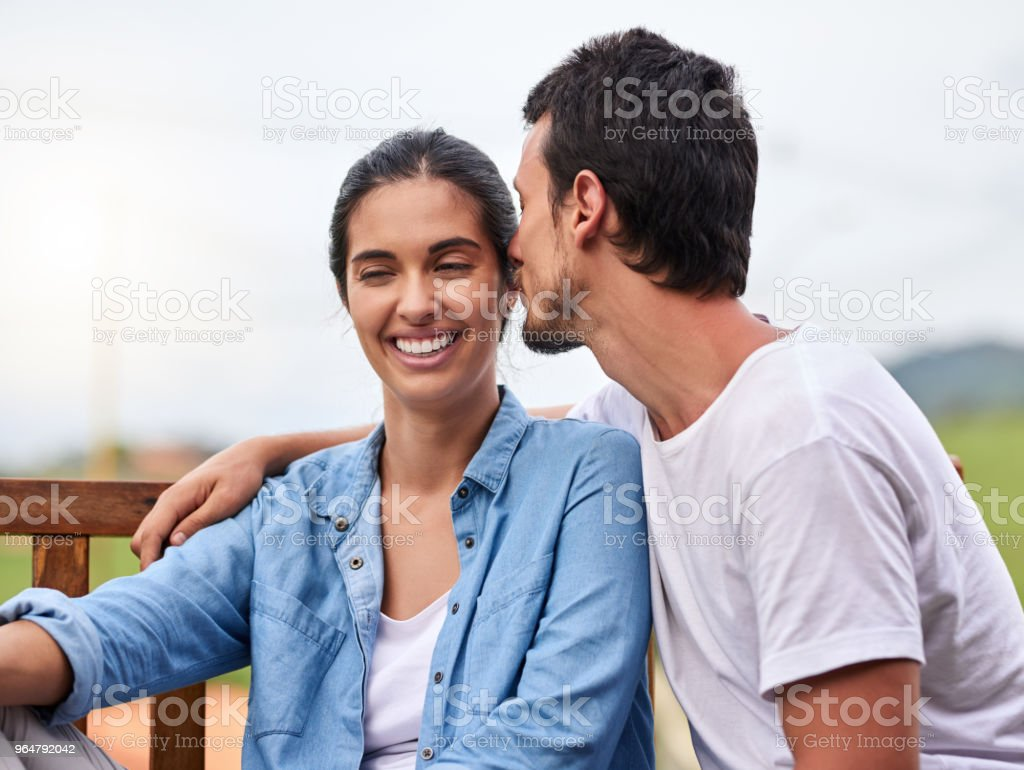 He shows her plenty of affection royalty-free stock photo