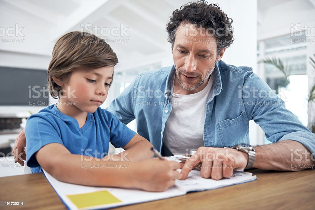 He takes an active role in his son's education stock photo