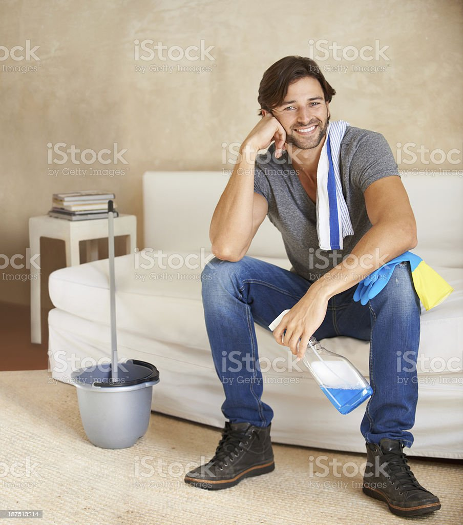 He takes pride in a clean home royalty-free stock photo