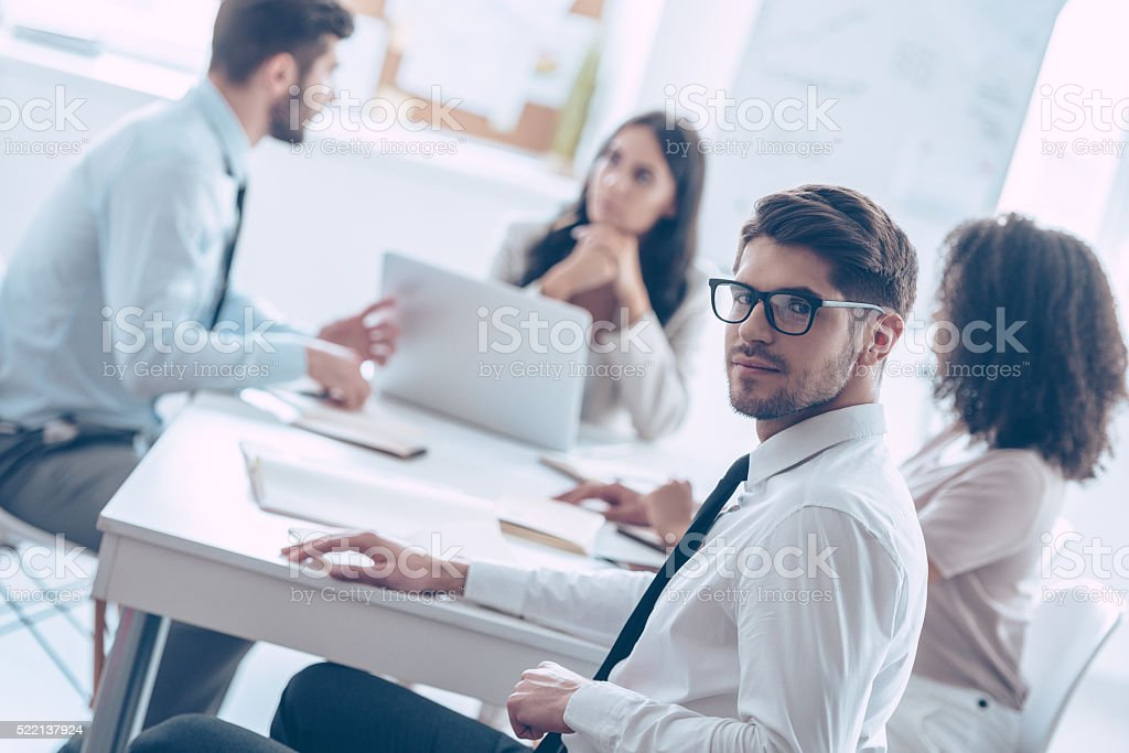 He trusts his business team. stock photo