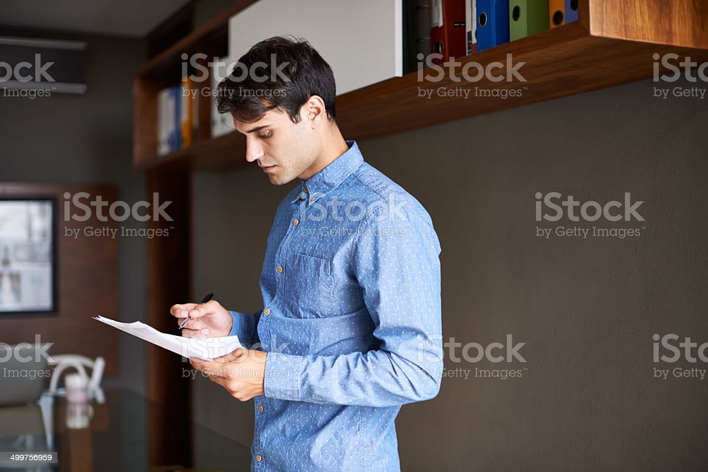 He wants his report to be absolutely perfect stock photo