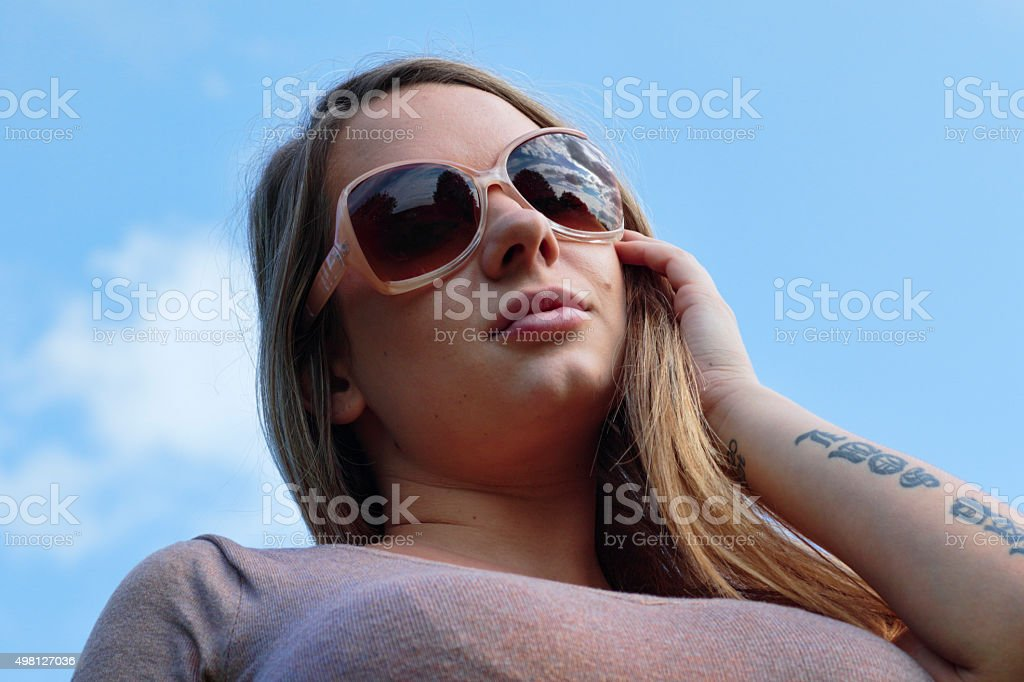 Blonde shapely woman against the sky outdoor Polish girl stock photo