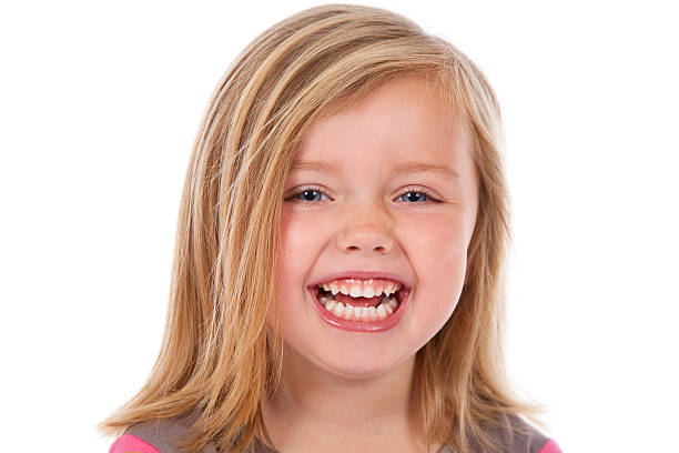 head and shoulders of laughing blond girl on white stock photo