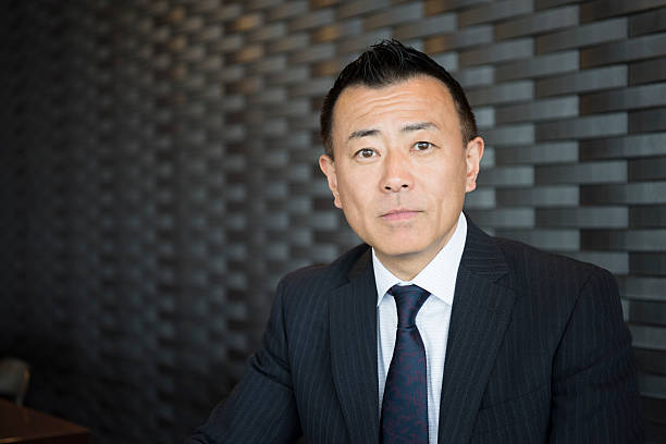 Head and shoulders portrait of Japanese businessman stock photo