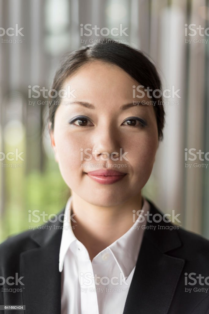 Head and shoulders portrait of Japanese businesswoman stock photo