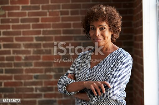 istock Head And Shoulders Portrait Of Mature Businesswoman 637153972