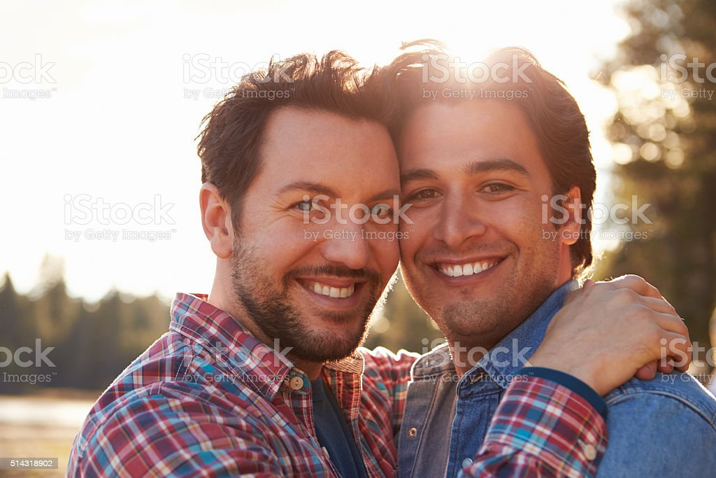 Head And Shoulders Portrait Of Romantic Male Gay Couple stock photo