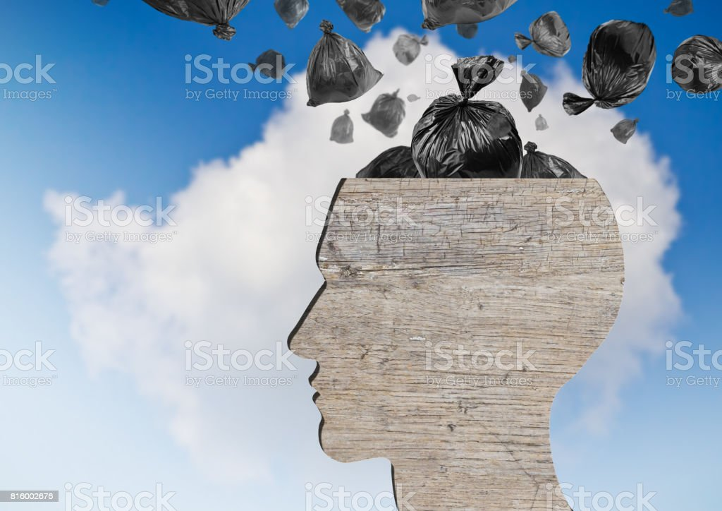 Head as wooden dustbin and falling garbage bags stock photo