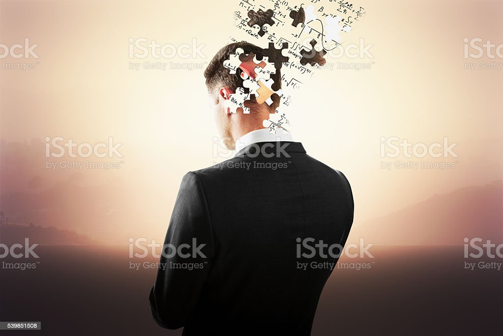 Head breaking into puzzle pieces stock photo