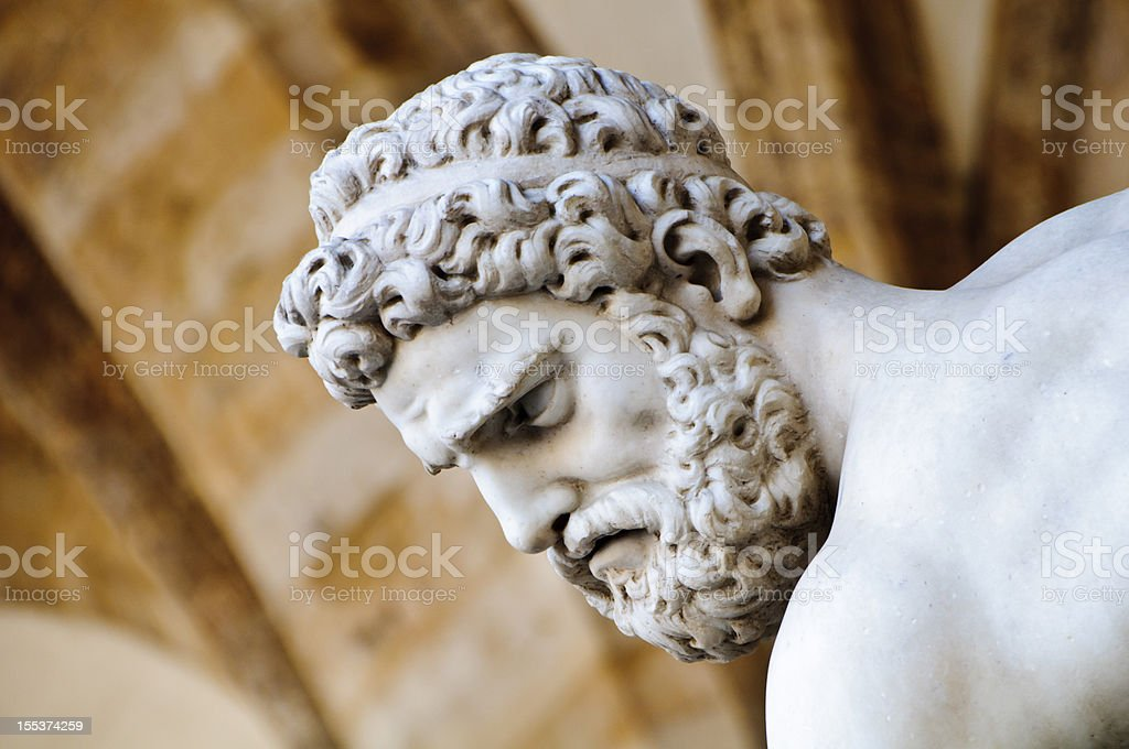 Head detail of stone sculpture of Hercules stock photo
