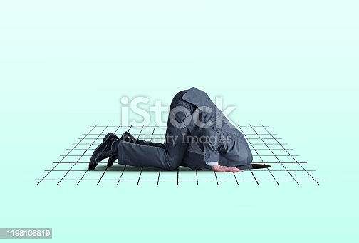 A man kneels on all fours as he places his head into a hole in the ground that is overlayed with a graph representing the financial markets.