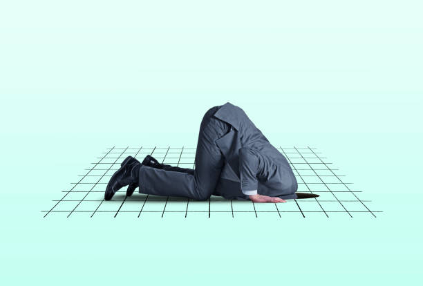Head In Financial Hole A man kneels on all fours as he places his head into a hole in the ground that is overlayed with a graph representing the financial markets. head in the sand stock pictures, royalty-free photos & images