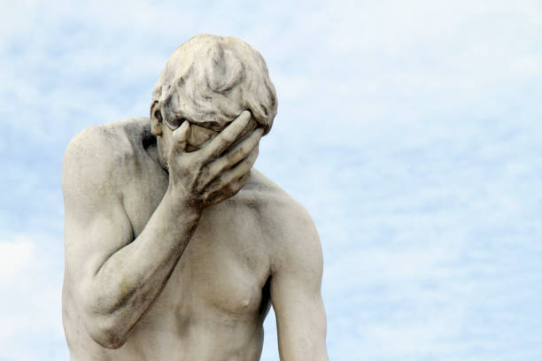 "Head in hands: Facepalm statue, ashamed, sad, depressed Marble statue with head in hands in front of blue sky (Statue: ""Cain"" by Henri Vidal, 1896, in the public Tuileries Garden, Paris, France) head in hands stock pictures, royalty-free photos & images"