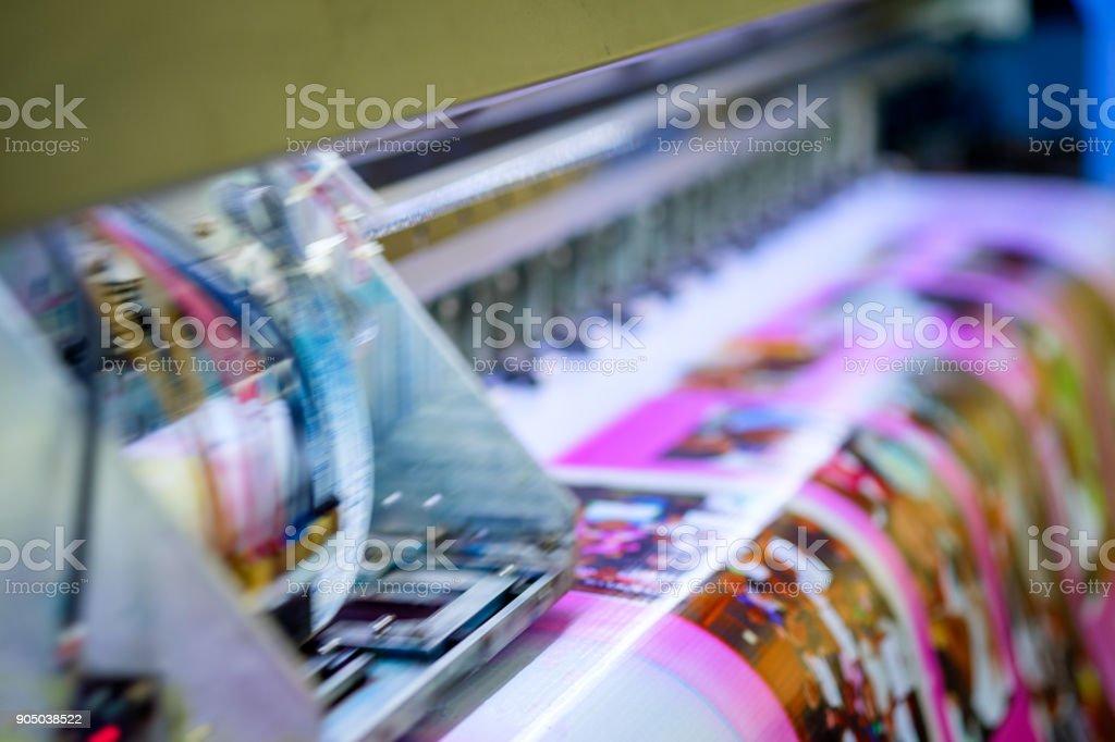 Head inkjet during printing on vinyl banner stock photo