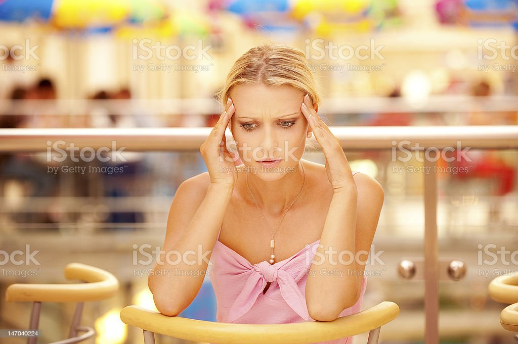 Head is ill young woman stock photo