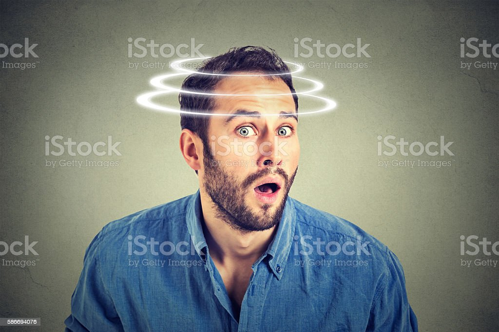 Head is spinning. Surprise astonished man stock photo