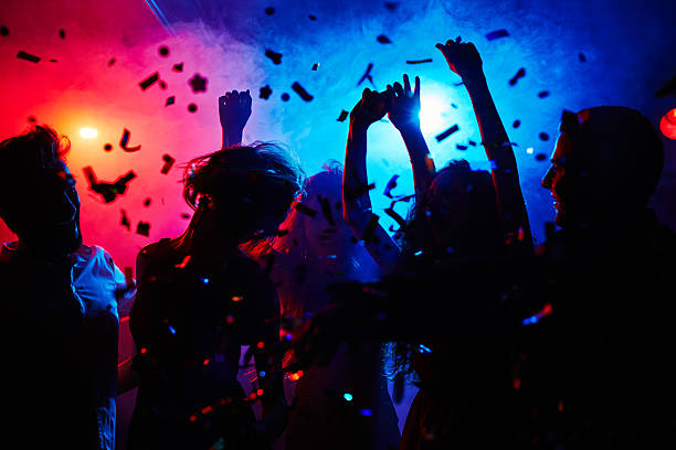 Head is swimming on dance floor Silhouettes of dancers moving in confetti nightclub stock pictures, royalty-free photos & images