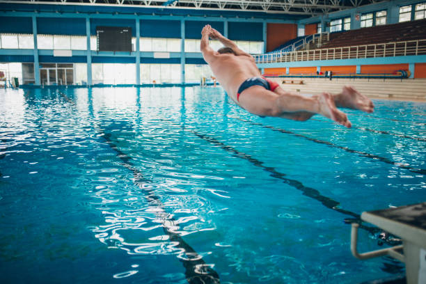 head jump in the swimming pool - competition group stock photos and pictures