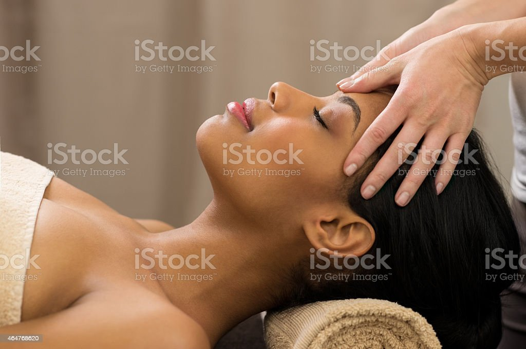 Head massage at spa stock photo