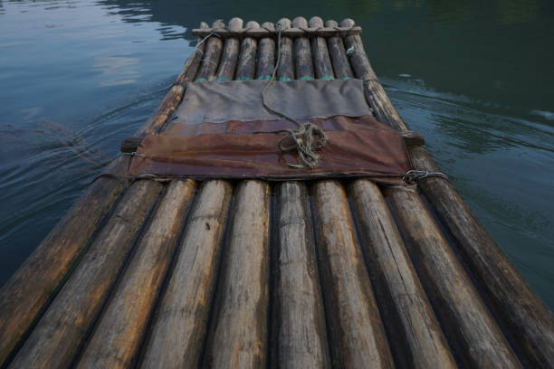 Head of a bamboo raft on water stock photo