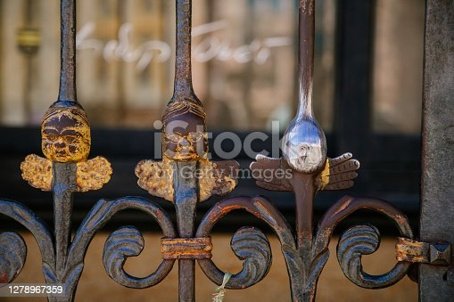 istock Head of a little angel for good luck on a decorative lattice near St. Bartholomew's Cathedral on the main Republic square of Plzen, Pilsen, Western Bohemia, Czech Republic, August 1, 2020 1278967359