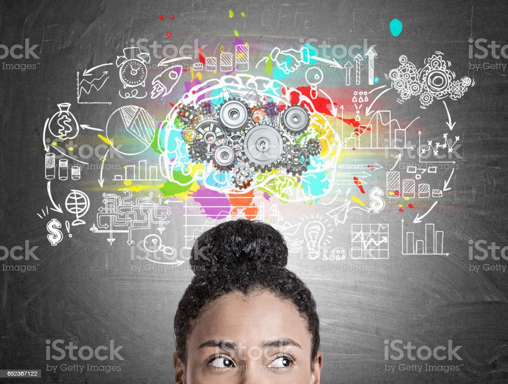 Head of African American woman, gears and brain stock photo
