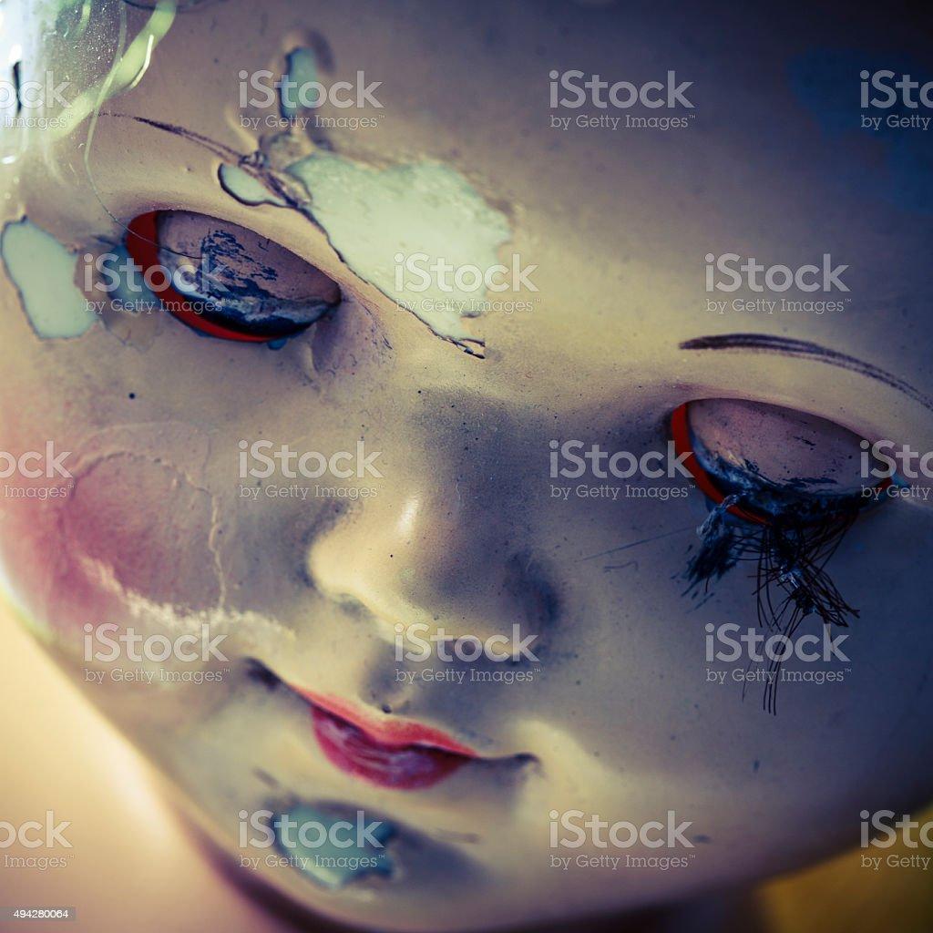 head of beatiful scary doll like from horror movie stock photo