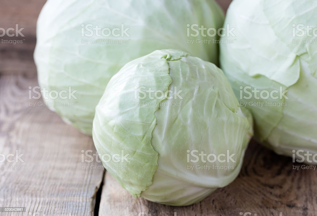 Head of cabbage on old wooden desk stock photo
