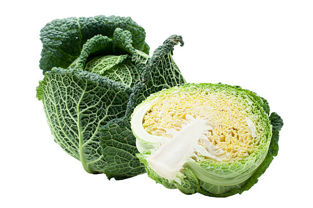 Head of ripe Savoy cabbage and half isolated stock photo