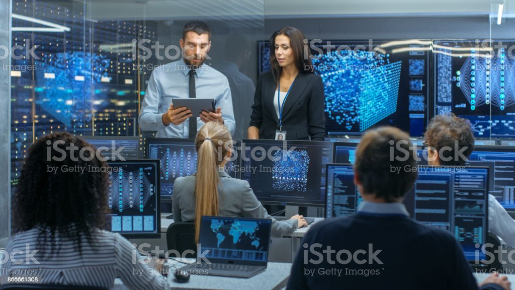 Head of the Department and Project Manager Discuss Work Process Using Data on Tablet Computer. Multi-Ethnic Team Builds Neural Network with Integrated Machine Learning. stock photo