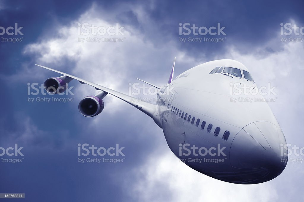 Head On View of Airliner with Stormy Sky stock photo