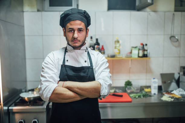 Chef Male chef standing in kitchen chef's whites stock pictures, royalty-free photos & images