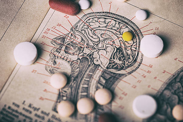 head section with pills - anatomie buch stock-fotos und bilder