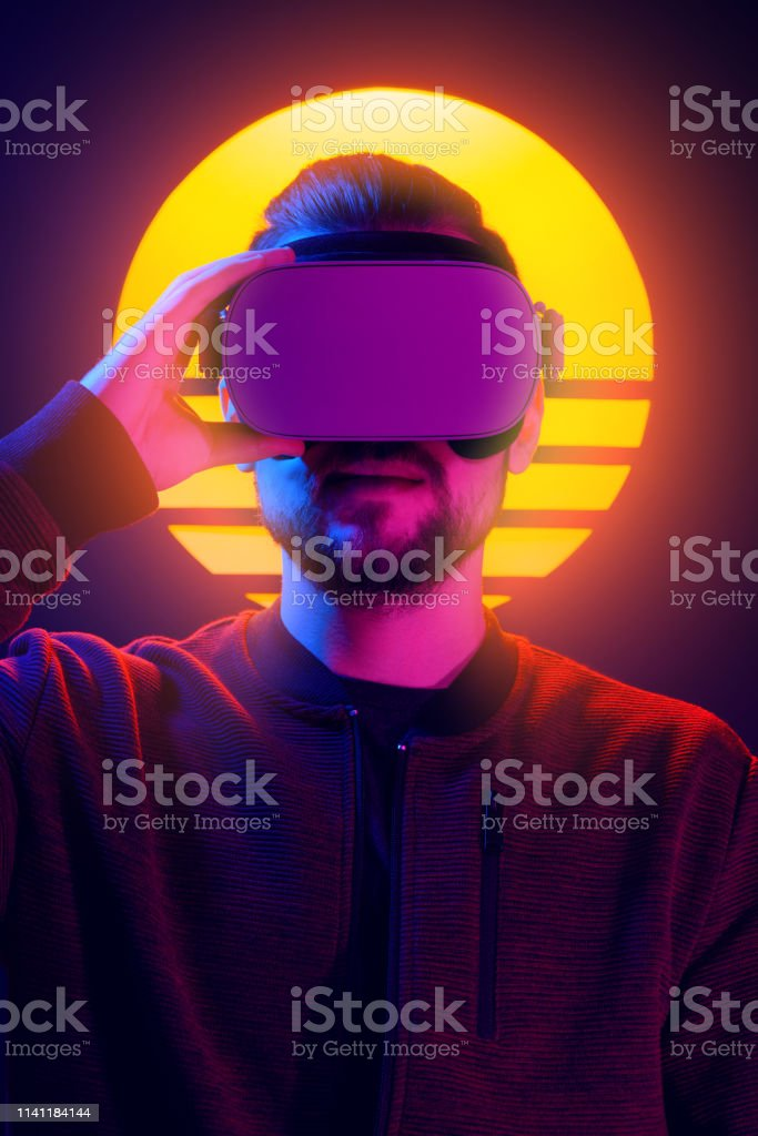Vr Head Set Videogame In 80s Synthwave And Retrowave Futuristic Vaporwave  Aesthetics Stock Photo - Download Image Now