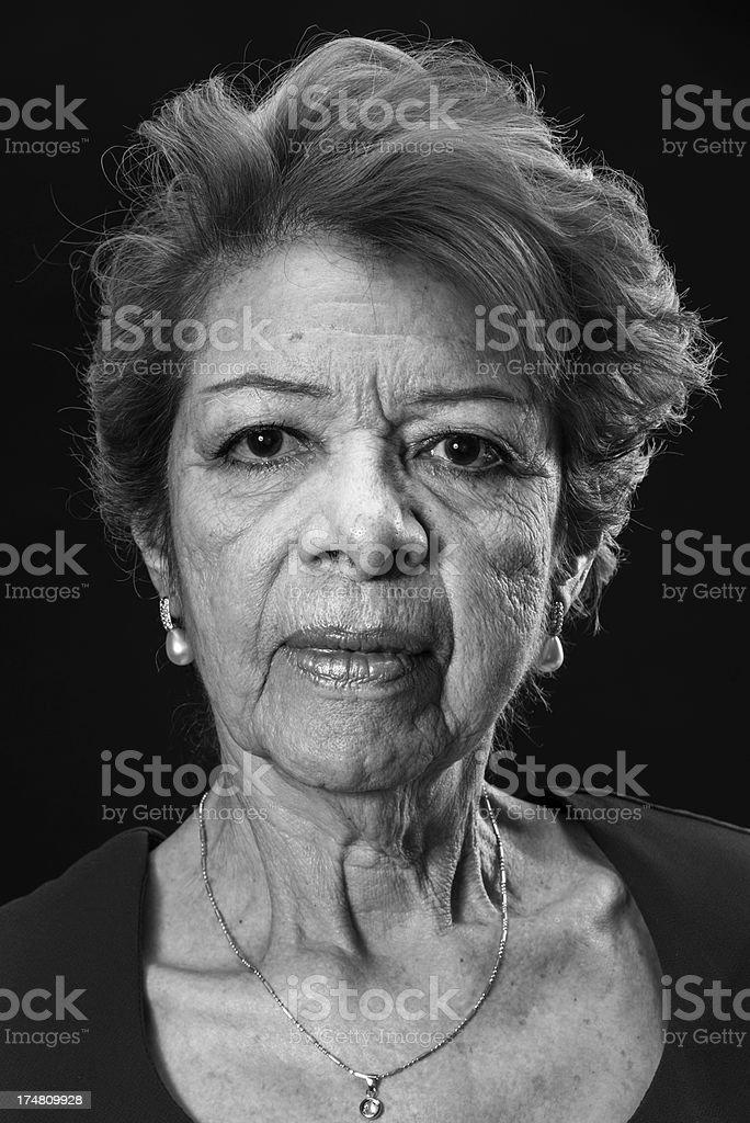 Head shot of a senior Hispanic woman in black and white royalty-free stock photo
