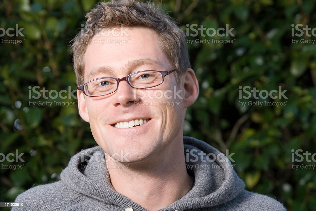 Head shot of Man wearing glasses and hoodie royalty-free stock photo