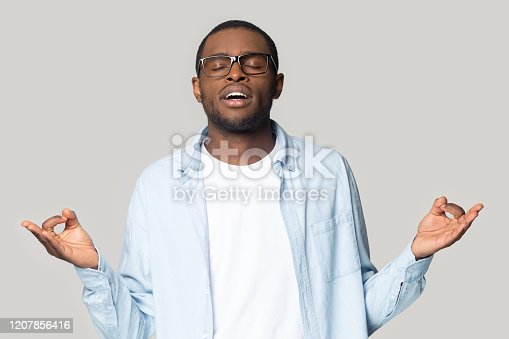istock Head shot peaceful young african american guy reducing stress. 1207856416