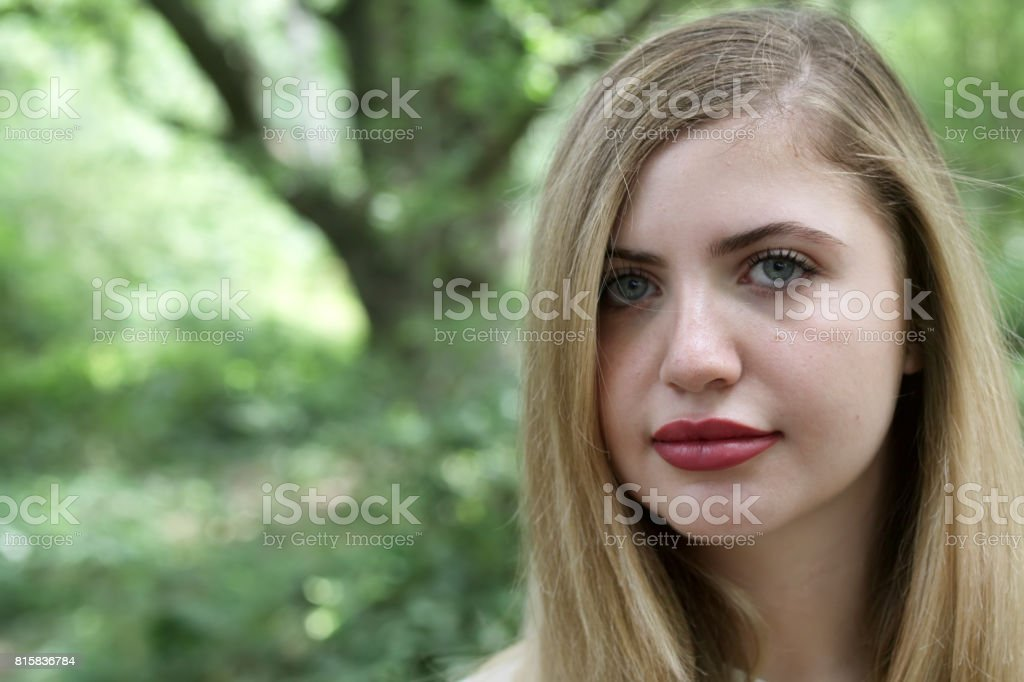 Head shot portrait beautiful young blonde Bulgarian outdoor girl in woodland stock photo