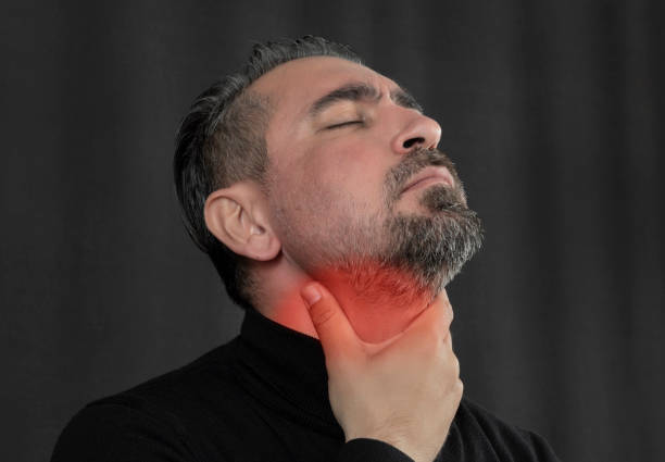 Head shot portrait man touch neck feels pain in throat Head shot portrait man touch neck feels pain in throat heartburn throat pain stock pictures, royalty-free photos & images