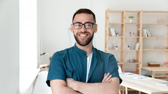 825082848 istock photo Head shot portrait of happy young confident businessman in eyeglasses. 1208424356