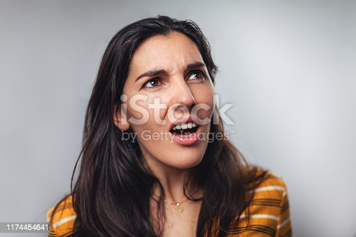 WTF! Head shot portrait of shocked frustrated young woman against to gray background