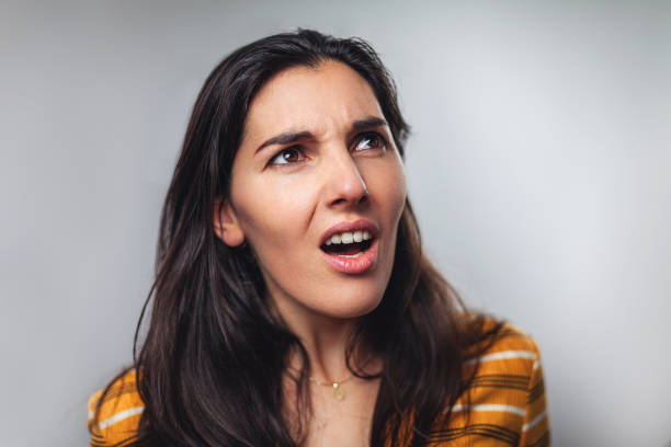 WTF! Head shot portrait of shocked frustrated woman WTF! Head shot portrait of shocked frustrated young woman against to gray background grimacing stock pictures, royalty-free photos & images