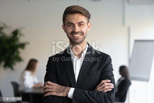 825082848istockphoto Head shot portrait of young happy confident businessman. 1191132083