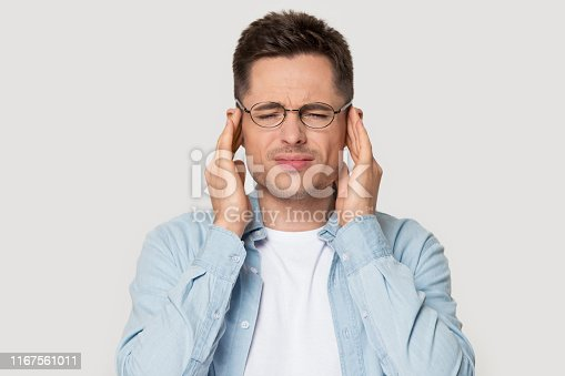 626964348istockphoto Head shot portrait stressed man touching temples suffers from headache 1167561011